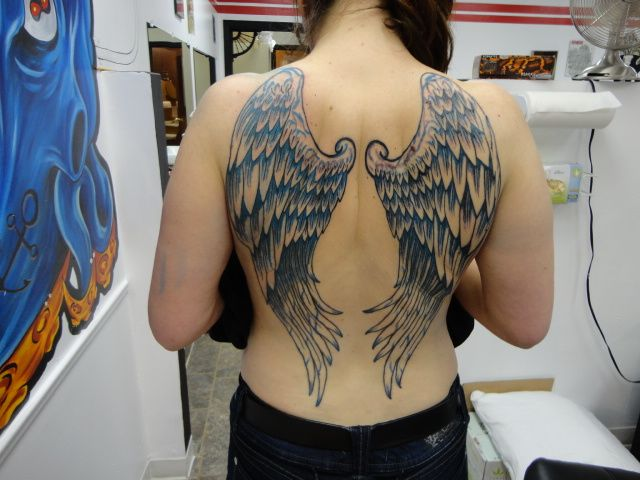 She had Angel Wings tattooed on her back – Ace Tattoo & Piercing